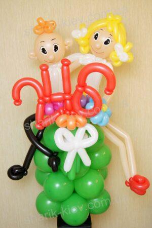 Ученик и ученица из воздушных шаров